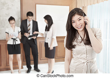 Busineswoman on the phone - Chinese businesswoman is on the...
