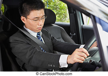 Falling asleep in car - Chinese businessman inside car...