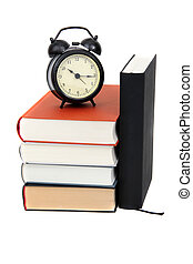 stack of books with alarm bell on white
