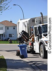 Garbage Truck in Action - A garbage truck emptying garbage...