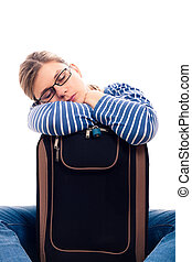 Tired traveller tourist woman sleeping on luggage