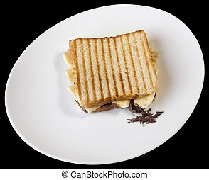 Toasted Cheese Sandwich on White Plate Isolated on Black...