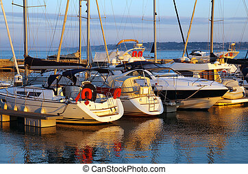 Docked Yachts - Serene scene of a marina with docked yachts...