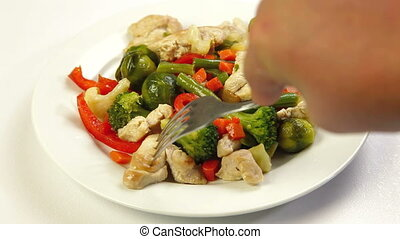 Eating Chicken and Vegetable Stir Fry