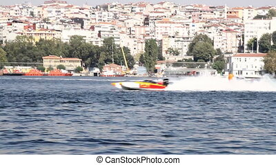 Speed Boat - A racing boat speeds along the water