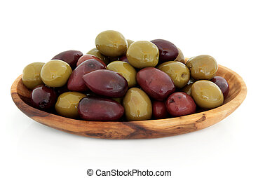 Olives - Green and black olives in an olive wood bowl over...