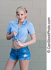 Blonde - Blue eyed blonde in a check shirt and denim shorts