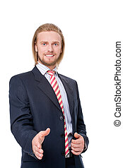 Businessman offering a handshake - Young businessman...