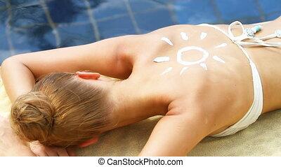Beautiful woman lying close to pool - Young beautiful woman...