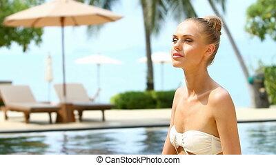 Adorable woman taking sun bath clos - Adorable young woman...