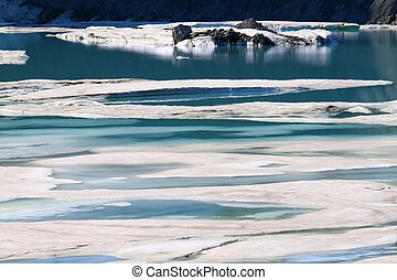 Glacial Meltwater from Grinnell Glacier - Ice floats amidst...
