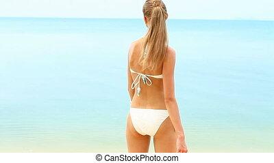 Happy smiling woman in bikini enjoy