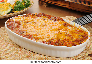 Taco casserole - A chicken enchillada casserole topped with...