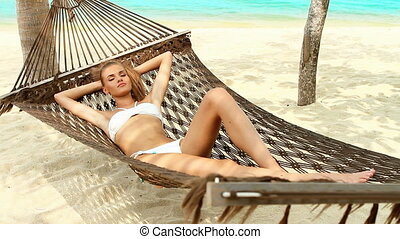 Cute woman relaxing in a hammock - Attractive woman...