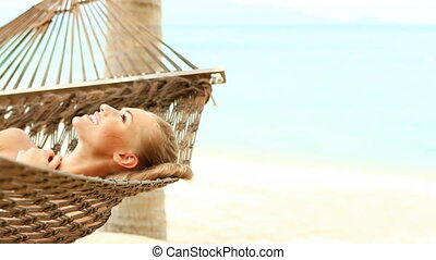 Cute woman laying on hammock - Cute woman lying on hammock...