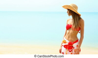 Happy girl in red bikini at tropica