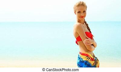 Woman in pareo and bikini at tropic - Woman wearing pareo...