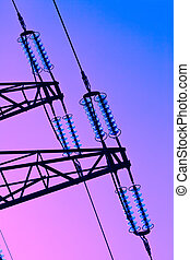 electricity pylon - the poles of a power line against a blue...