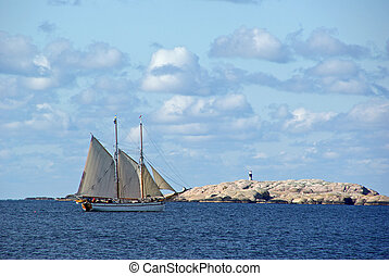 Sailing ship - Tall ship and red granite rocks on the...