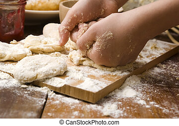Detail of hands kneading dough