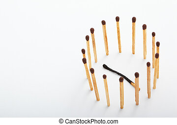 The fallen burnt match being surrounded by the unburnt ones
