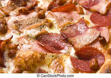 Italian pizza with bacon, salami and mozzarella cheese
