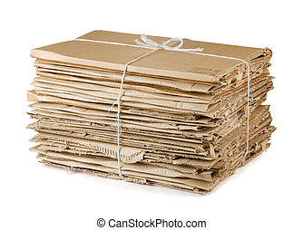 Waste cardboard bundle for recycling isolated on white