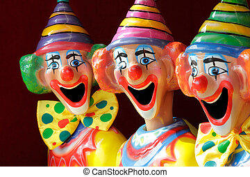 Sideshow Carnival Clowns - A row of sideshow carnival game...