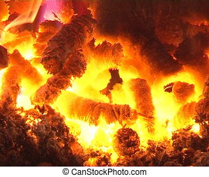 burn straw pellet boiler - closeup of burn straw pellets in...