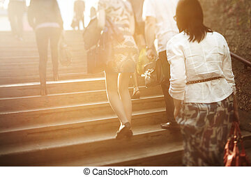 city people - unrecognizable people are blurred with a...