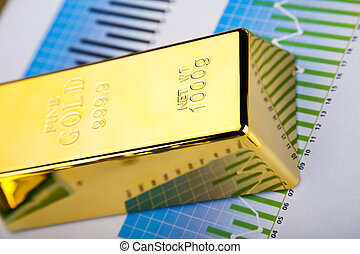 Monthly report,Finance Concept - Gold bars with a linear...