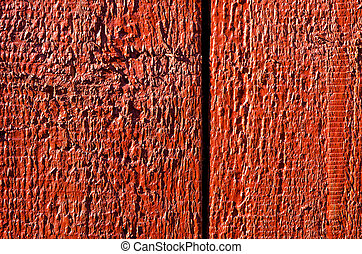 Background of wooden board plank wall painted red