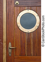 Old ship door with a window