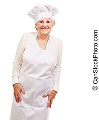 portrait of cook senior woman smiling over white background