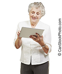 portrait of senior woman touching digital tablet over white...