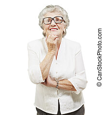 portrait of senior woman thinking and looking up over white...