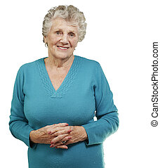 portrait of senior woman standing over white background