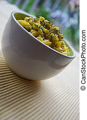 Yellow rice in white bowl