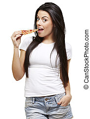 woman eating pizza - young woman eating a piece of pizza...