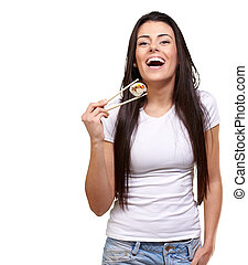portrait of young woman holding sushi against a white...