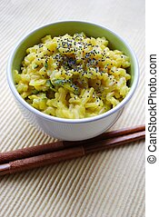 Yellow rice and chopsticks