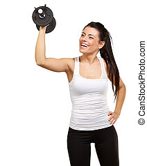 portrait of young girl training with weights over white background