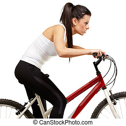 young sporty girl cycling over white background