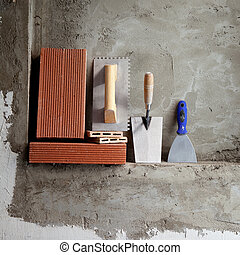 construction stainless steel trowel tools and bricks