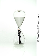 Businesswoman stops time from the hourglass