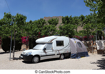 Camper van with tent on a camping site in Spain