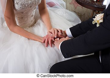 gentle hands of the groom and bride - Close-up photo of...