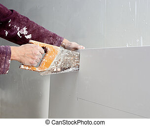 cutting plasterboard plaster hand dirty saw - cutting...
