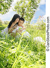 couple sitting on the grass