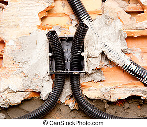 electrical coil conduit pipe on box embedded in wall -...